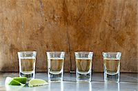 Row of tequila shots Stock Photo - Premium Royalty-Freenull, Code: 614-06002075