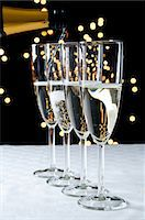 Pouring glasses of champagne Stock Photo - Premium Royalty-Freenull, Code: 614-06002083