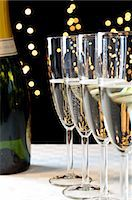 Bottle and glasses of champagne Stock Photo - Premium Royalty-Freenull, Code: 614-06002087