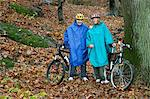 Portrait of mature couple on cycle ride in forest Stock Photo - Premium Royalty-Freenull, Code: 614-06002097