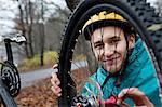Young man fixing bicycle wheel in forest Stock Photo - Premium Royalty-Free, Artist: Ascent Xmedia, Code: 614-06002116