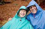 Portrait of senior couple sitting on park bench wearing waterproofs Stock Photo - Premium Royalty-Free, Artist: Janet Foster, Code: 614-06002119