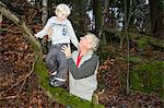 Grandfather holding boy on tree branch Stock Photo - Premium Royalty-Free, Artist: AWL Images, Code: 614-06002134