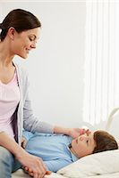 Woman looking after her ill son Stock Photo - Premium Royalty-Freenull, Code: 614-06002138