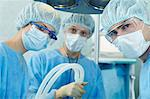 Surgeons in scrubs during operation Stock Photo - Premium Royalty-Free, Artist: Masterfile, Code: 614-06002152