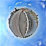 A couple in Zaanse Schans, Netherlands, little planet effect Stock Photo - Premium Royalty-Free, Artist: Blend Images, Code: 614-06002161