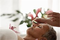 Senior woman relaxing on massage table Stock Photo - Premium Royalty-Freenull, Code: 614-06002272