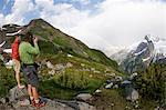 Photographing rainbow in mountains, White Rock Lakes, Ptarmigan Traverse, North Cascades, Washington, USA Stock Photo - Premium Royalty-Free, Artist: Scanpix Creative         , Code: 614-06002336