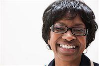 Portrait of mature African American businesswoman, studio shot Stock Photo - Premium Royalty-Freenull, Code: 614-06002407