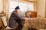 Senior man tuning radio Stock Photo - Premium Royalty-Free, Artist: Cultura RM, Code: 614-06002525
