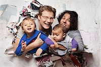 Happy family busting through a wall Stock Photo - Premium Royalty-Freenull, Code: 614-06002610