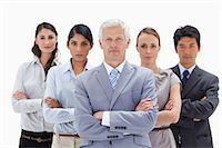 Close-up of a multicultural business team behind their boss against white background Stock Photo - Premium Royalty-Freenull, Code: 6109-06002702