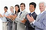 Close-up of multicultural business people posing and applauding against white background Stock Photo - Premium Royalty-Free, Artist: Blend Images, Code: 6109-06002765