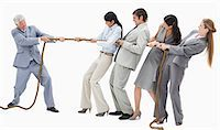 Boss pulling a rope against his employees with white background Stock Photo - Premium Royalty-Freenull, Code: 6109-06002807