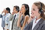Professionals listening with headsets against white background Stock Photo - Premium Royalty-Freenull, Code: 6109-06002810