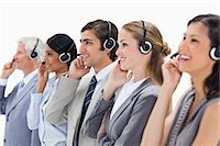 switchboard operator - Professionals listening happily with headsets against white background Stock Photo - Premium Royalty-Freenull, Code: 6109-06002816