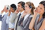 Smiling professionals listening wearing a headsets against white background Stock Photo - Premium Royalty-Freenull, Code: 6109-06002817