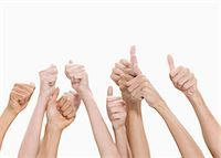 Thumbs up and hands raised against white background Stock Photo - Premium Royalty-Freenull, Code: 6109-06002868