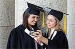 Young graduating student taking a picture of herself and her smiling friend Stock Photo - Premium Royalty-Free, Artist: Jean-Christophe Riou, Code: 6109-06003578