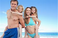 Happy young family having a nice day on the beach together Stock Photo - Premium Royalty-Freenull, Code: 6109-06003649