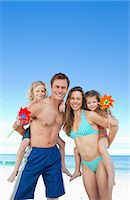 Jolly young family spending their day on the beach Stock Photo - Premium Royalty-Freenull, Code: 6109-06003651