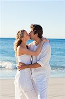 Kissing young couple on the beach Stock Photo - Premium Royalty-Freenull, Code: 6109-06003803