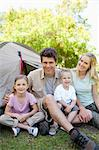 A smiling father and mother take their kids to the park to experience camping Stock Photo - Premium Royalty-Free, Artist: CulturaRM, Code: 6109-06003867