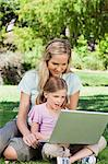 A mom and her daughter surfing the internet together on a laptop in the park Stock Photo - Premium Royalty-Free, Artist: CulturaRM, Code: 6109-06003971