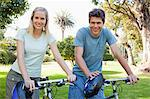 Couple spending their day together on their bikes in the park Stock Photo - Premium Royalty-Free, Artist: CulturaRM, Code: 6109-06004023