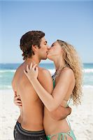 Young couple standing on the beach while kissing each other Stock Photo - Premium Royalty-Freenull, Code: 6109-06004084