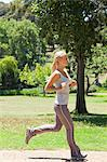 Side view of a running young sportswoman Stock Photo - Premium Royalty-Free, Artist: Ron Fehling, Code: 6109-06004313