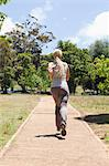 Back view of a jogging young woman Stock Photo - Premium Royalty-Free, Artist: Beyond Fotomedia, Code: 6109-06004316