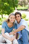 Happy young couple sitting on the lawn Stock Photo - Premium Royalty-Free, Artist: Robert Harding Images, Code: 6109-06004379