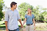 Smiling young couple taking a walk in the park Stock Photo - Premium Royalty-Free, Artist: Minden Pictures, Code: 6109-06004475