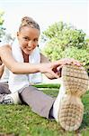 Smiling young sportswoman on the lawn doing her stretches Stock Photo - Premium Royalty-Free, Artist: CulturaRM, Code: 6109-06004556