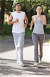 Young sportspeople jogging on an avenue Stock Photo - Premium Royalty-Free, Artist: CulturaRM, Code: 6109-06004562