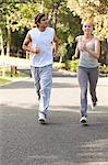 Young sportspeople jogging on a street Stock Photo - Premium Royalty-Free, Artist: Blend Images, Code: 6109-06004565