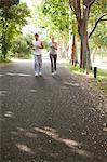 Young sportspeople jogging on a road together Stock Photo - Premium Royalty-Free, Artist: CulturaRM, Code: 6109-06004568