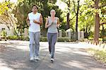 Young sportspeople jogging on a road together Stock Photo - Premium Royalty-Free, Artist: CulturaRM, Code: 6109-06004569