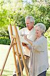 Man and a woman painting in a park Stock Photo - Premium Royalty-Free, Artist: CulturaRM, Code: 6109-06004808