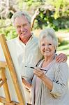 Man and a woman holding each other while painting in a park Stock Photo - Premium Royalty-Free, Artist: Shannon Ross, Code: 6109-06004812
