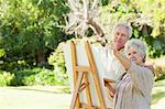 Man and a woman painting on a canvas in a park Stock Photo - Premium Royalty-Free, Artist: Aflo Relax, Code: 6109-06004814