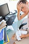 Businesswoman overwhelmed by work in a bright office Stock Photo - Premium Royalty-Free, Artist: Blend Images, Code: 6109-06005519