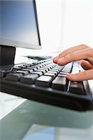 Close-up of man hands typing on a keyboard in a bright office Stock Photo - Premium Royalty-Freenull, Code: 6109-06005535