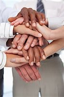 piles of work - Several hands put together for teamwork gesture Stock Photo - Premium Royalty-Freenull, Code: 6109-06005790