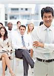 Businessman with his arms crossed while his colleagues stand behind him Stock Photo - Premium Royalty-Free, Artist: CulturaRM, Code: 6109-06007256
