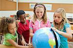Elementary students exploring globe together Stock Photo - Premium Royalty-Free, Artist: Universal Images Group, Code: 6109-06007391