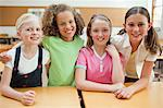 Smiling schoolgirls standing together behind desk Stock Photo - Premium Royalty-Free, Artist: Robert Harding Images, Code: 6109-06007401