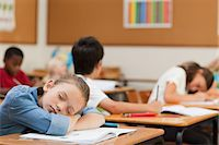 Side view of young schoolgirl taking a nap Stock Photo - Premium Royalty-Freenull, Code: 6109-06007469