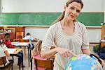 Elementary teacher standing next to globe Stock Photo - Premium Royalty-Free, Artist: I Dream Stock, Code: 6109-06007574